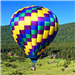 Purple, Yellow, Green, and Blue Hot Air Balloon Flying