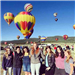 Ground of Women Standing In Front of Hot Air Balloons
