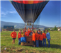 Group of People Inside and Around the Hot Air Balloon Basket