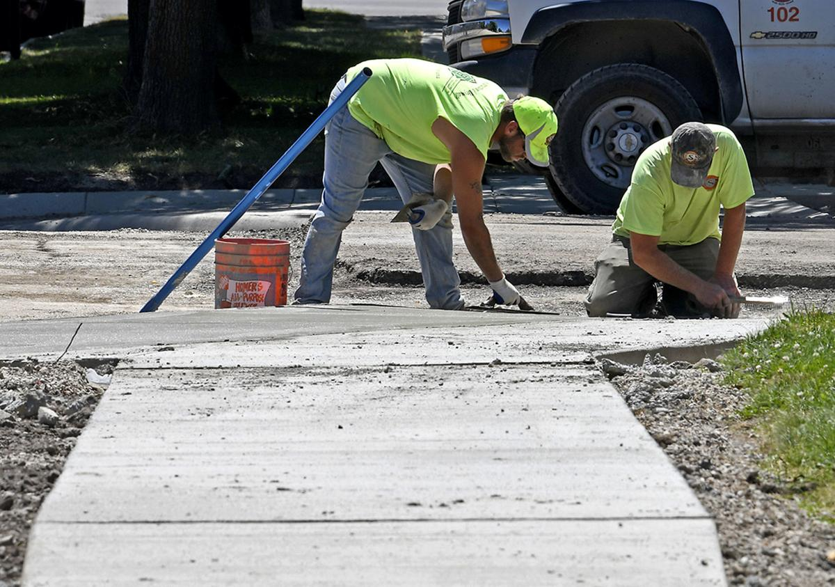 Construction men working on a sidewalk